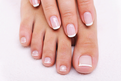 Beauty nails of a female hand and feet